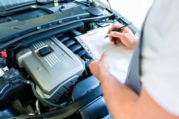 mechanic checking vehicle mot